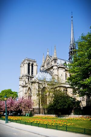 Facade and apse of cathedral Notre Dame, Paris, France  photo