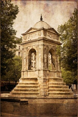 Fountain of innocents in vintage style, Paris, France photo