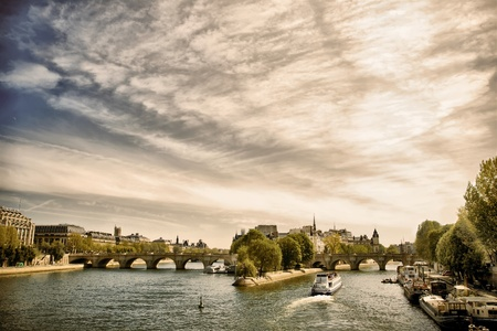 cite: View of Cite island from the Seine river, Paris, France