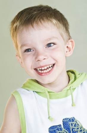 Happy little boy with sweet smile Stock Photo - 10252066
