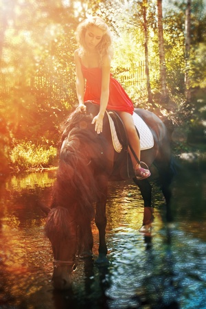 horseback: Beautiful young woman and horse on river Stock Photo