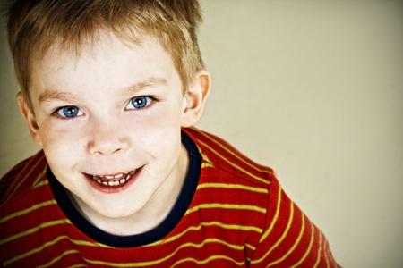Happy little boy with blue eyes Stock Photo - 10252065