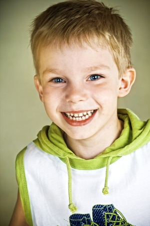 Happy smiling little boy with blue eyes Stock Photo - 10252073