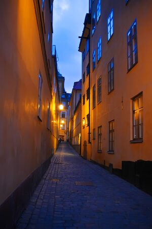 narrow: Night street in Stockholm, Sweden Stock Photo