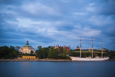 Stockholm beautiful night view with castle and boat photo