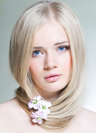 Beautiful young girl with white hair and blue eyes Stock Photo