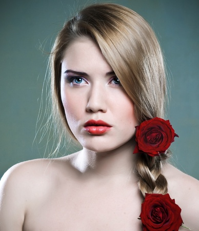 Beautiful young woman with perfect face and roses photo