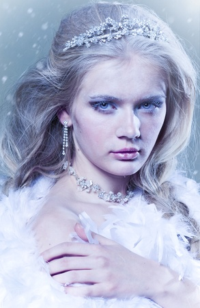 Beautiful winter queen with ice sight photo