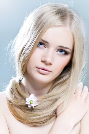 Beautiful young girl with white hair and healthy skin photo