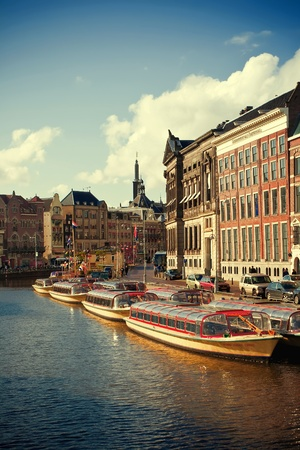 Beautiful view of Amsterdam canals with a boat  Urban scene