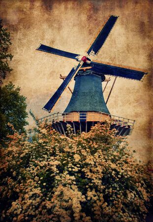 Old mill in Keukenhof, Holland Stock Photo - 18756635