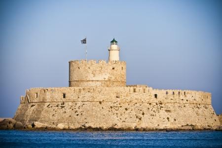 st nicholas: Saint Nikolas Fortress, Mandraki harbor, Rhodes, Greece Stock Photo