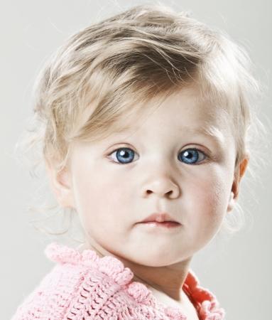 Beautiful baby girl with big blue eyes closeup  photo