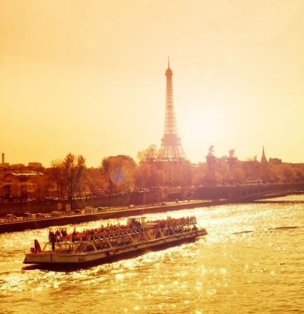 Beautiful golden sunset in Seine river, Paris, France photo