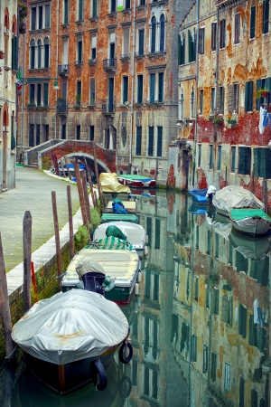 Traditional venetian canal, Venice, Italy photo
