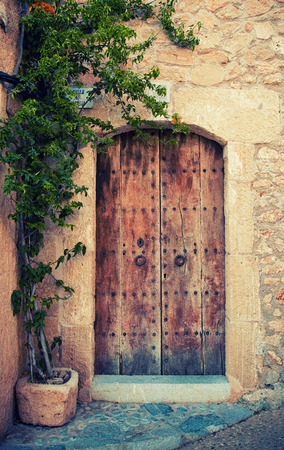 admission: Medieval door of castle in Mallorca, Balearic island, Spain