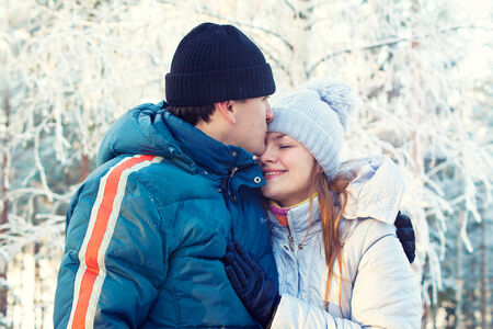 couple winter: Happy couple in winter forest Stock Photo