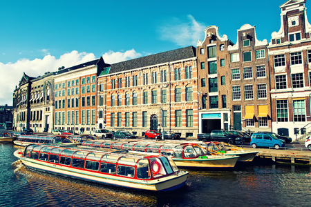 amstel river: Beautiful view of Amsterdam canals with boat, Holland
