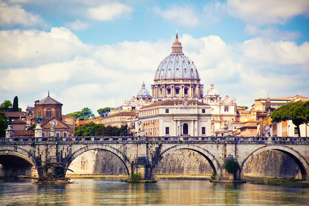 View of Saint Peter cathedral and bridge Saint Angel, Rome, Italy photo