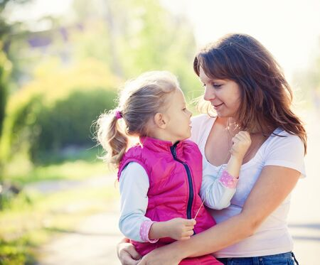 Mother and daughhter in summer day photo