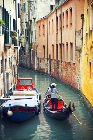 Gondolier in venetian canal, Venice, Italy