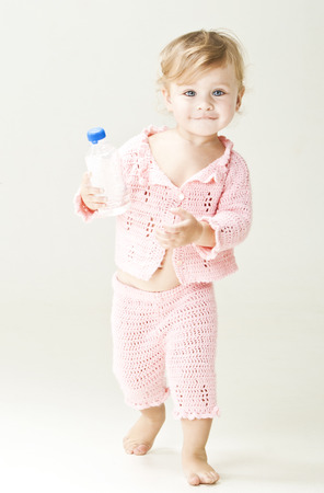 Beautiful little girl with bottle of water photo