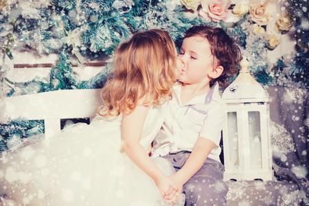 Christmas kiss of little boy and girl Stock Photo