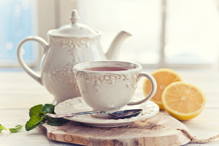 Teapot and teacup in vintage style Stock Photo