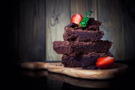 party pastries: Chocolate cake with strawberry, dark photo