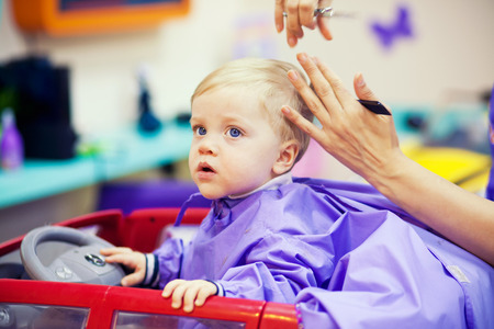 First haircut of little year old boy