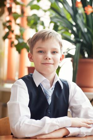 schoolboy: Smart schoolboy in school classroom