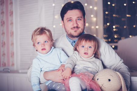 Happy father with twin kids boy and girl photo