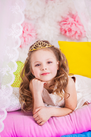 Little beautiful princess on the bed