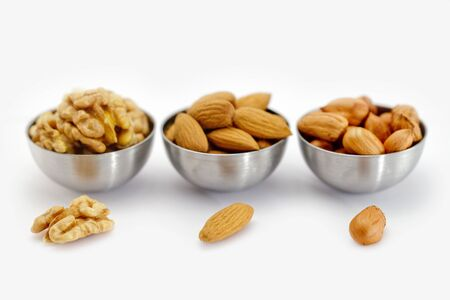 Three bowl with nuts. photo