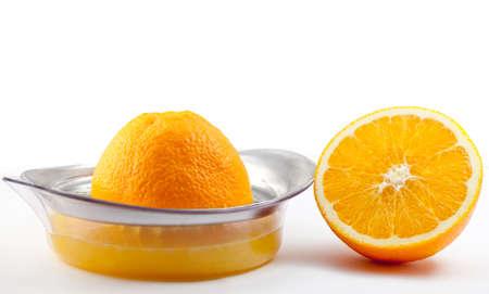 Orange with juicer on white background. Stock Photo