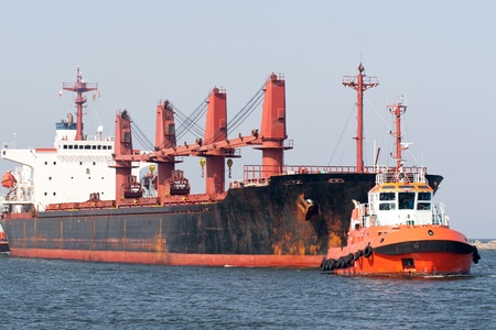 tugboat: Big ship and tugboat. Gdansk, Poland. Stock Photo