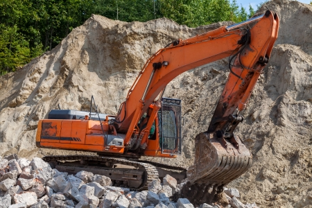 Excavator working with sand and stones  photo