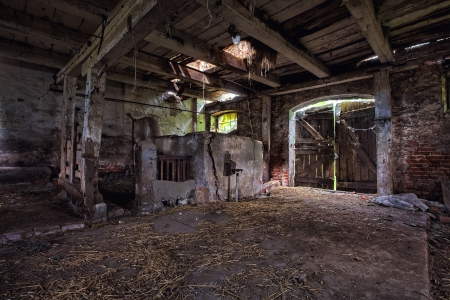 Old, built of wood and brick, abandoned barn  Stock Photo - 22477180