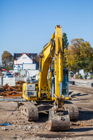 Excavator standing in the construction site  photo
