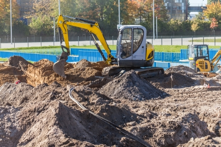 mini loader: A small excavator on a construction site  Gdansk, Poland  Stock Photo