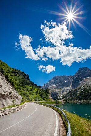 Summer view of Fedaia lake beneath Marmolada mountain  photo