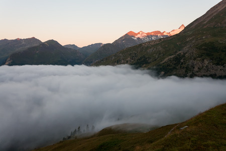 The morning and the rising sun in the Alps  photo
