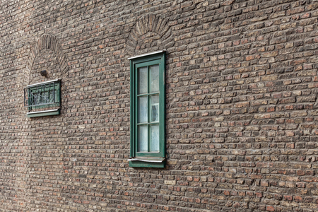 Window on the wall of a historic building photo
