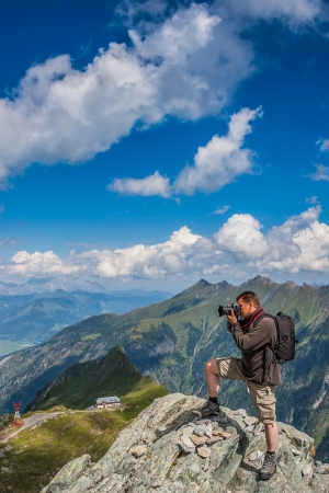 Photographer taking pictures on the rocks in the Alps - Austria. photo