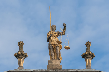 Sculpture of Themis with scales and sword  photo