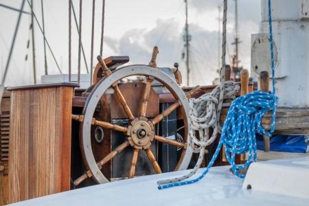 Steering wheel on sailboat  photo