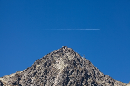 Airplane over Lomnicky peak in the Tatra Mountains photo