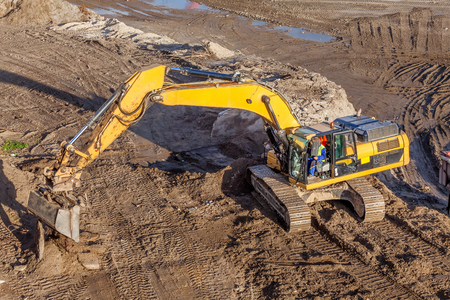 Working excavator on a construction site