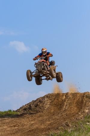 quad: Jump on the ATV - extreme sports Stock Photo