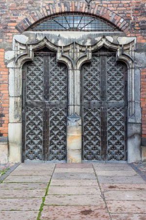 The big, wooden, decorated gates to St Marys Church in Gdansk, Poland photo